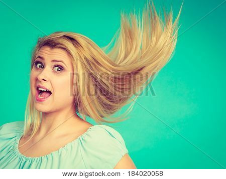 Shocked Amazed Blonde Woman With Crazy Windblown Hair