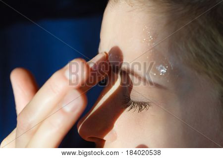 Young Woman Applying Gel Mask On Face