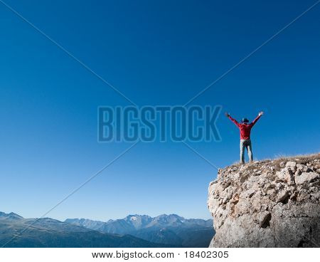 man hiking in a mountain