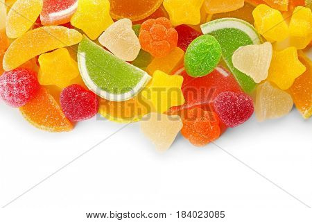 Fruit jelly candies on white background