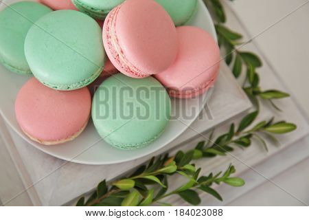 Plate with macarons on wooden stand