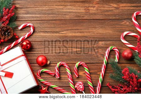 Christmas candy canes and decor on wooden  background