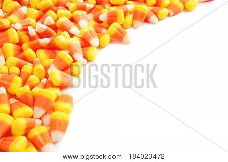 Colorful Halloween candy corns on white background
