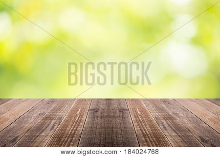 Old wood coordination table top on nature background Space available for the product