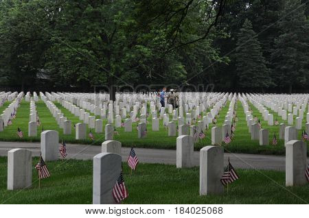 Zachary Taylor National Cemetery, boy scouts placing flags in front of tombstones for Memorial Day, May 28th, 2016