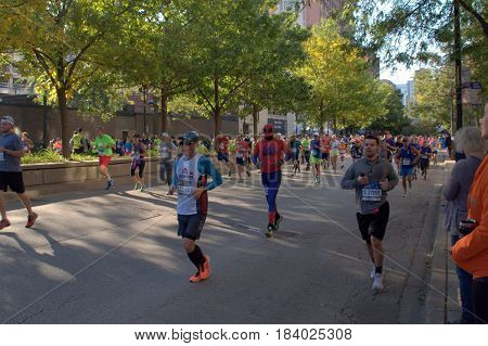 people running down LaSalle Boulevard in the Chicago Marathon, October 9th, 2016