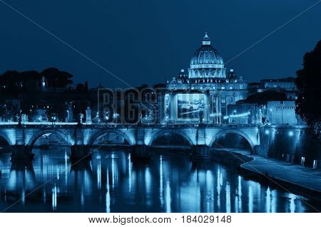 River Tiber in Rome with Vatican City St Peters Basilica and Ponte Sant Angelo at night