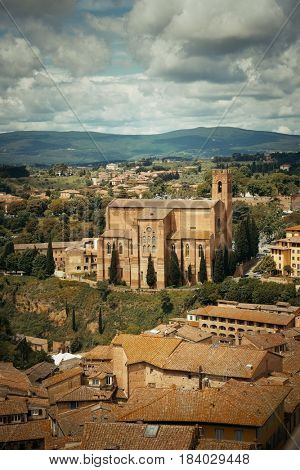 Medieval town Siena skyline view with Basilica of San Domenico in Italy