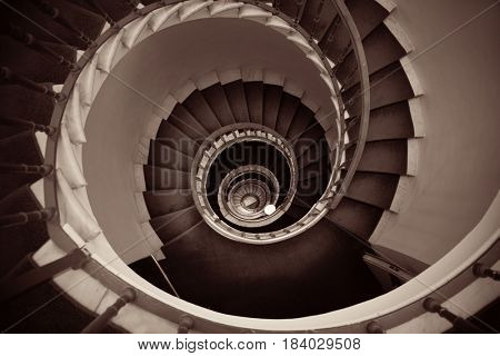 Spiral staircase in old building in Rome, Italy.