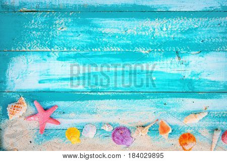 Summer background - starfish shells coral on wood table background. vintage color tone styles.