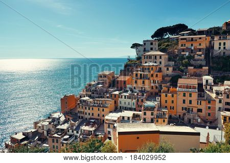 Riomaggiore waterfront view with buildings in Cinque Terre, Italy.