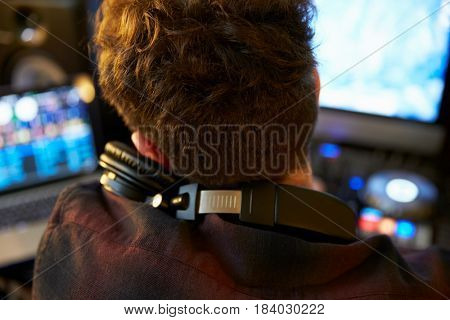 Young Man Mixing Music using Headphones