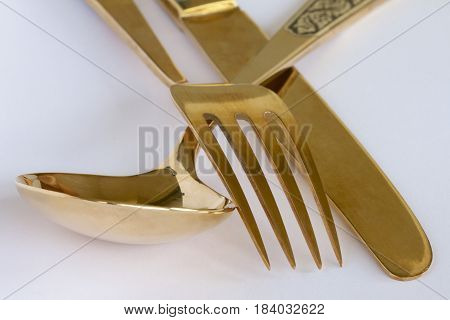Thai gold setting of knife, fork and spoon.