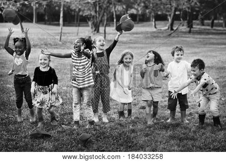 Group of Diverse Kids Playing at the Field Together