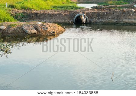 Water drainage by the road to allow water to pass through the drain.