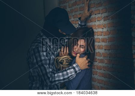 Sexual Abuse With A Terrorist Attacking A Scared Woman In A Dark Place. Rape And Sexual Abuse Concep