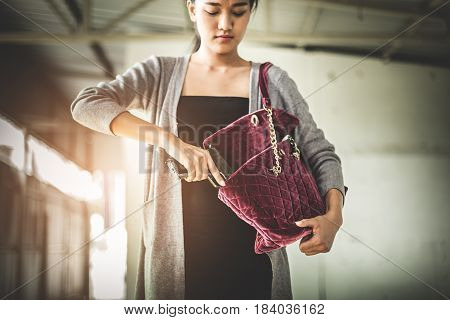 Woman Pulls A Gun From Her Swanky Purse. Conceal Carry Weapon For Protection Themselves Concept. Sel