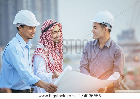 Muslim Business And Engineer Working Concept: Two Engineers And Muslim Businessmen Discussing About