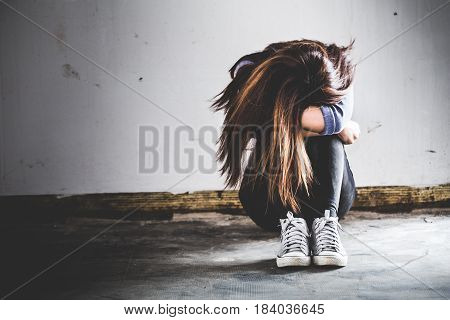 Sad Woman Sitting Alone In A Empty Room. Sressful Concept.