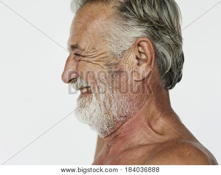 Man standing topless and posing for photoshoot