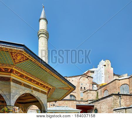 The social compex (kulliye) of Hagia Sophia with Fountain for ritual ablutions to the fore Istanbul Turkey