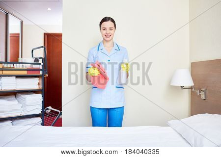 Housekeeper in clean uniform working in hotel