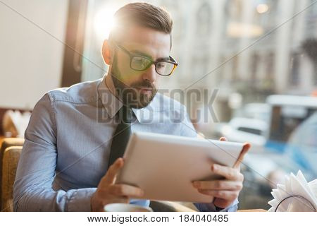 Serious trader looking through financial data online