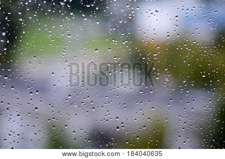 Close up photography. Rain drops on the window.