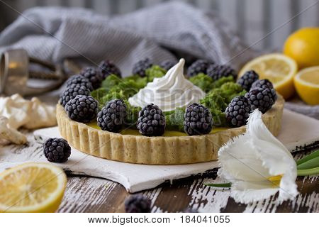 Delicious Homemade Lemon Tart. Pie On Rustic White Table. Tart With Blackberry And Meringue