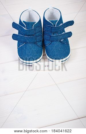 Pregnancy Test With Positive Result And Baby Shoes For Newborn, Expecting For Baby