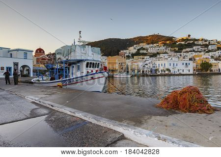 AGIA MARINA, GREECE - MARCH 25, 2017: Fishing boat in the port of Agia Marina village on Leros island in Greece early in the morning on March 25, 2017.