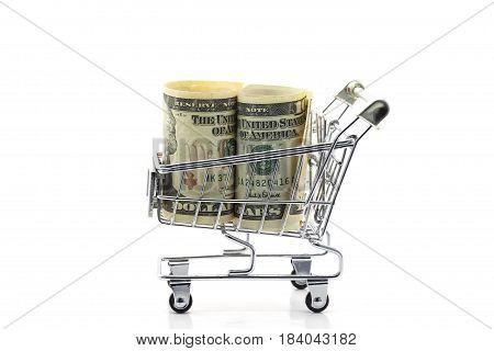 Dollar bank note on shopping cart isolated on white background