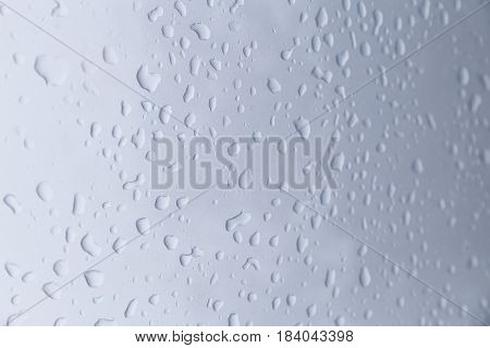 Drops of rain on a blue background