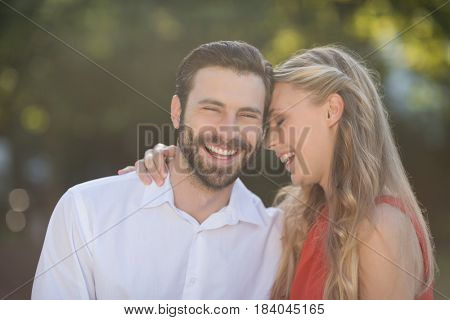 Romantic couple enjoying in park on a sunny day