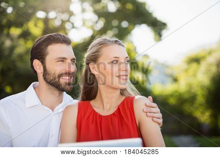 Romantic couple together in park on a sunny day