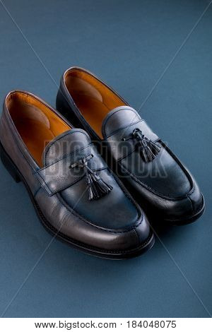Blue Loafer Shoes On Blue Background. One Pair. Top View.