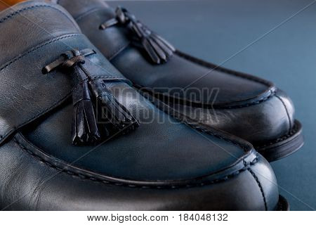 Blue Loafer Shoes On Blue Background. One Pair. Close Up.