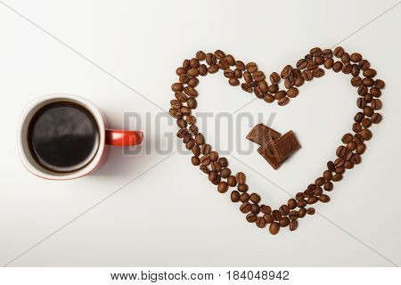 Cup Of Hot Coffee And Heart Made Of Coffee Beans White Table