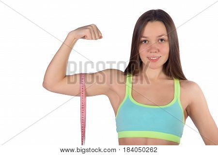 Fitness Woman Measures Biceps Muscle