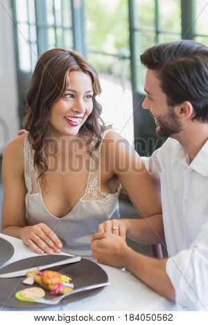 Man holding womans hand in the restaurant