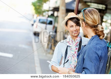 Girl and guy on the streets of a city