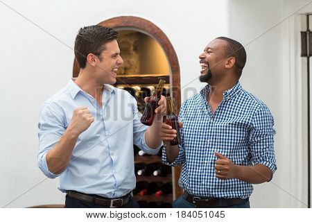 Friends cheering while having beer in the restaurant
