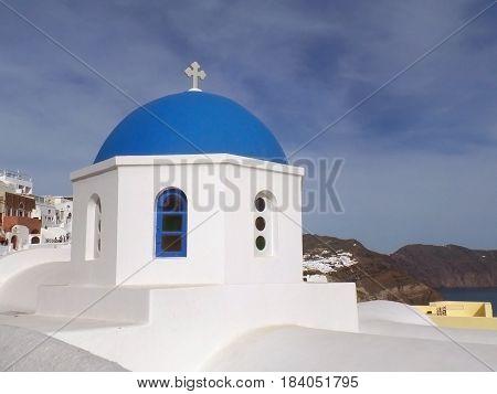 The unique pure white and vivid blue Greek islands style church at Oia village on Santorini island, Greece