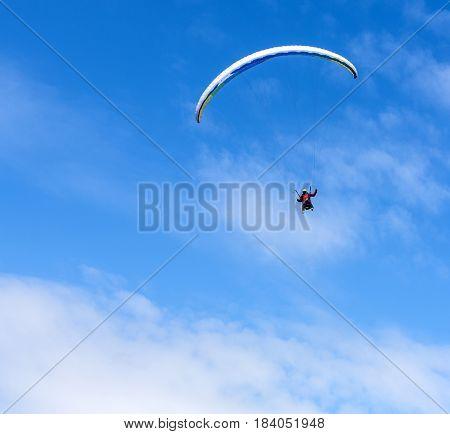 Paraglider flies paraglider in the sky. Paragliding.