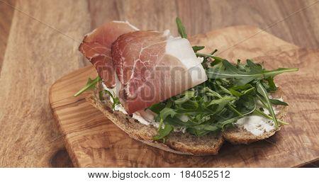 sandwich with italian speck, arugula and cream cheese, 4k photo