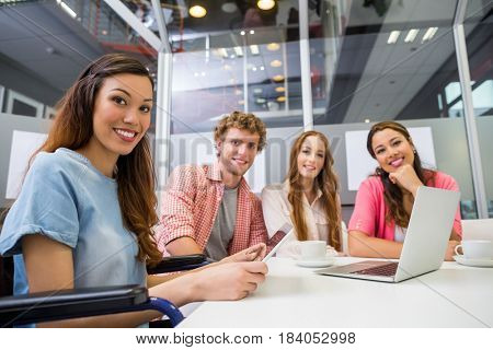 Portrait of smiling executives in conference room at office