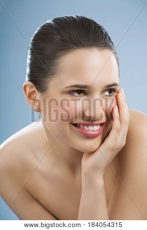 Young Woman On Blue Background