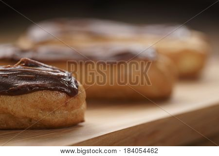 traditional french eclairs with chocolate ganache, shallow focus