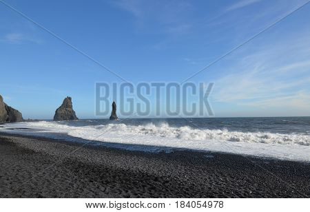 Rock formations of the coast of Reynisfjara beach in Vik Iceland.