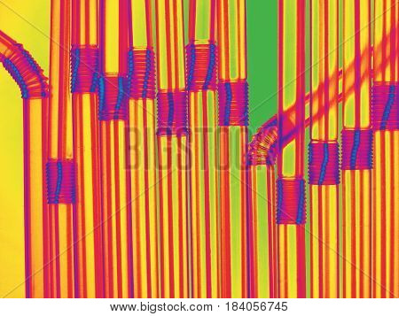 Coctail pattern close-up. Creative flat lay texture, original fence made of plastic striped pipes. Restaurant, bar, drinks, healthy meal, amusement.